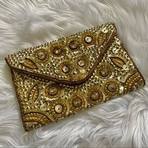 Charming Charlie's gold sequin clutch